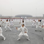 Participants practice Taichi on a square during a Guinness World Record attempt of  the largest martial arts display, on a hazy day in Jiaozuo, Henan province, China, October 18, 2015. The city successfully set the record by organizing over 50,000 residents to practise shadow boxing simultaneously at 15 different locations on Sunday morning, local media reported. Picture taken October 18, 2015. REUTERS/Stringer CHINA OUT. NO COMMERCIAL OR EDITORIAL SALES IN CHINA